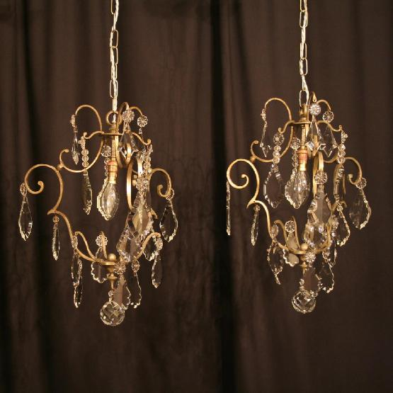 A French Pair Of Silver Antique Chandeliers